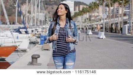Trendy jaunty young woman enjoying a stroll