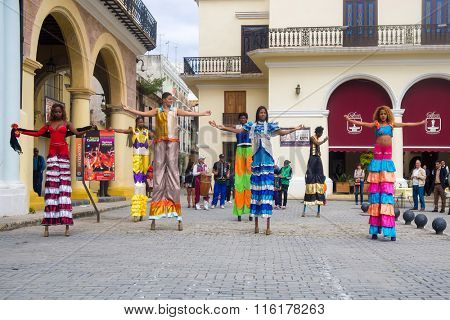 HAVANA,CUBA- JANUARY 24,2016 : Street performers dancing on stilts on a beautiful Old Havana square