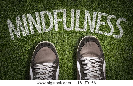 Top View of Sneakers on the grass with the text: Mindfulness