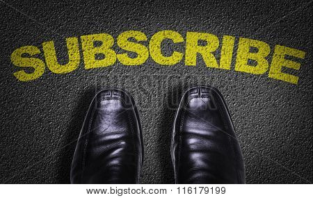 Top View of Business Shoes on the floor with the text: Subscribe