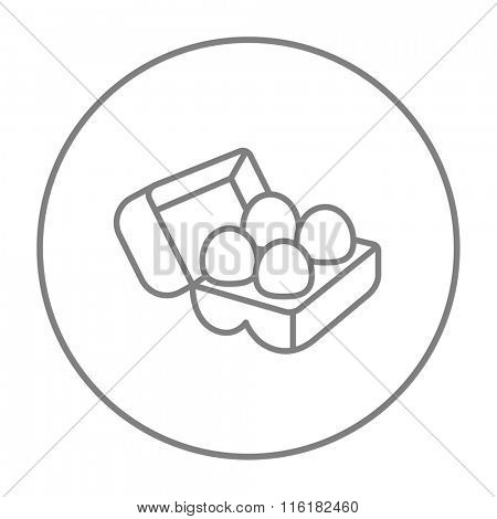 Eggs in carton package line icon.