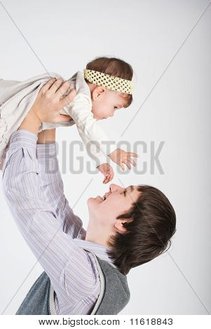 The Happy Father Plays With The Small Daughter