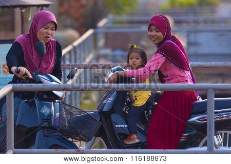 Muslim Cambodian Women On Motorbikes At Siem Reap City District Where Live Mostly Cambodians Of Isla