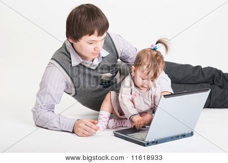 The Small Daughter Prevents To Work To The Father Behind The Lap