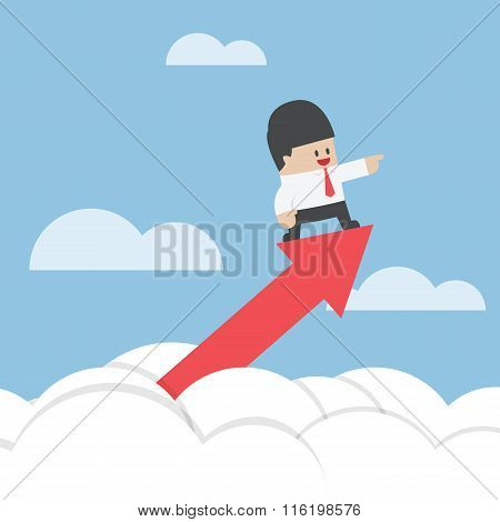 Businessman Standing On A Graph Soaring Through The Clouds