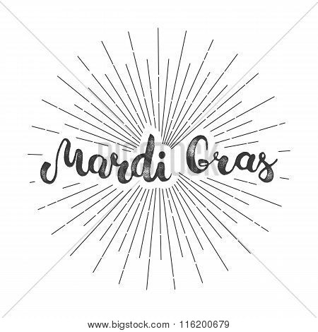 Mardi Gras hand lettering grunge calligraphic text Mardi Gras with light burst and rays. Colorful carnival mask for masquerade. Party background for carnival in New Orlean Shrove Tuesday Fat Tuesday