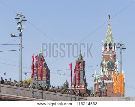 Spasskaya Tower And Officers Are On The Bridge