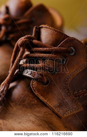 Detail Of Very Old Shoelaces On Leather Boots