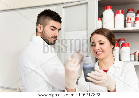 Scientists In Laboratory With Chemicals Testing Virus Vaccination