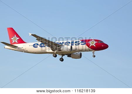 ZURICH - JULY 18: Edelweiss A-320 landing in Zurich airport on July 18, 2015 in Zurich, Switzerland. Zurich airport is home port for Swiss Air and several budget airlines.