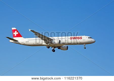 ZURICH - JULY 18: Swiss A-320 landing in Zurich airport on July 18, 2015 in Zurich, Switzerland. Zurich airport is home port for Swiss Air and one of the biggest european hubs.