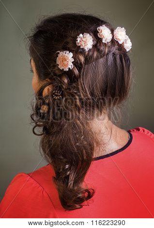 Brunette girl with floral barrettes