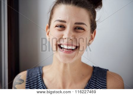 Beautiful Model Woman With Freckles Perfect Fresh Clean Skin. Female Looking At Camera And Laughing.