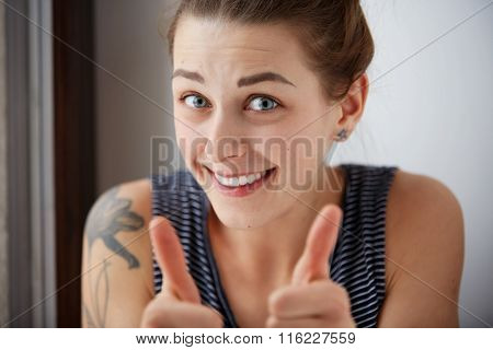 Portrait Of A Happy Young Successful Woman Giving Two Thumbs Up Gesture In Full Disbelief Isolated G