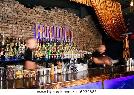 GRODNO BELARUS - NOV 7 2015: Two bartenders quickly working at a gastrobar HOUDINI in Grodno Belarus November, 7, 2015