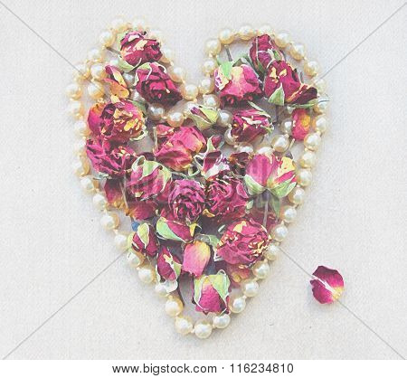 Gentle Background With Pink Rosebud, Petals And Heart Shaped Pearl Necklace Isolated On White