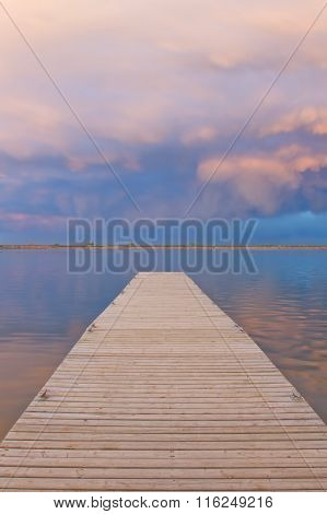 Sunset Over The Fishing Dock With Cumulonimbus Clouds