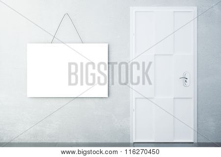 Blank White Picture On Concrete Wall With White Door In Empty Room, Mock Up