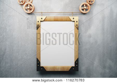 Blank wooden picture frame steampunk style on grey concrete wall. mock up poster