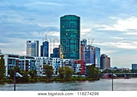 FRANKFURT, GERMANY - MAY 3,2011: cityview of Frankfurt with river Main and new appartments and office buildings at the riverside at sunset