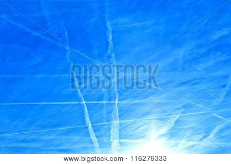 blue clear sky with condensation trails (contrail)