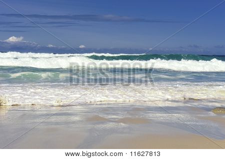 Crashing Waves Along The Shore Refelctions In The Sand