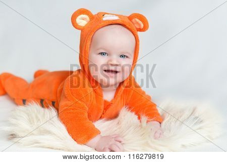 A Child In A Suit Of Orange Tiger Lies