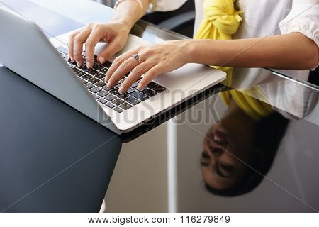 Business Woman Smiling And Typing On Office Laptop Computer