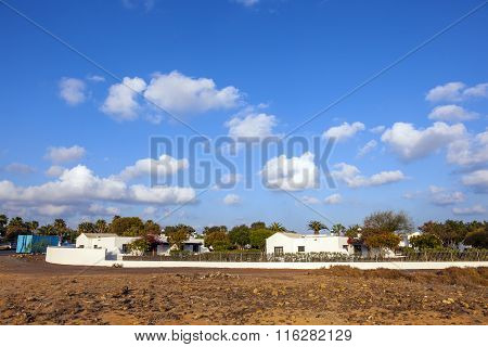 typical urbanisation resorts in Lanzarote Spain with palm trees