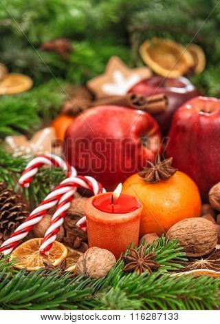 Christmas Holidays Backdround. Fruits, Spices And Candles
