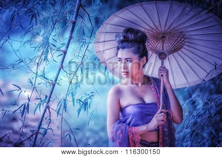 Ancient Thai Woman In Traditional Dress Of Thailand With Vintage Umbrella