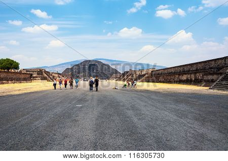 TEOTIHUACAN MEXICO - MARCH 14 2011: People at the famous mayan ruins. It is very popular site of Mesoamerican pyramids built in the pre-Columbian Americas listed a UNESCO World Heritage Site