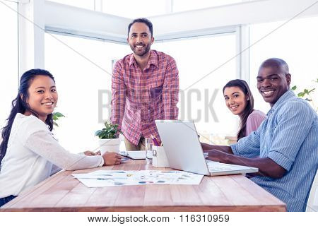 Happy multi ethnic business people in meeting room at creative office