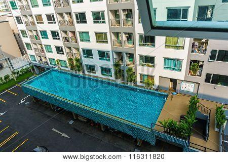 Swimming Pool Of Condominium On Sunny Day