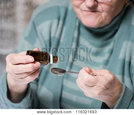 Mature Woman Dripping Medicated Drops