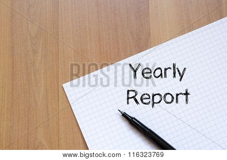 Yearly report text concept write on notebook with pen