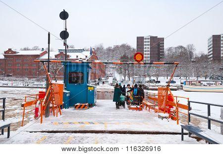Ordinary Passengers Loading On Small City Boat In Turku