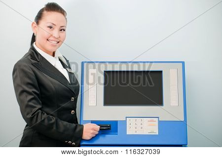 Bank worker by an ATM