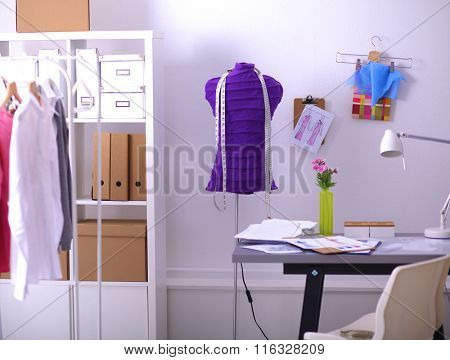 Work place with sew manikins, in office