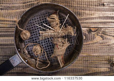Voodoo Doll Inside Pan
