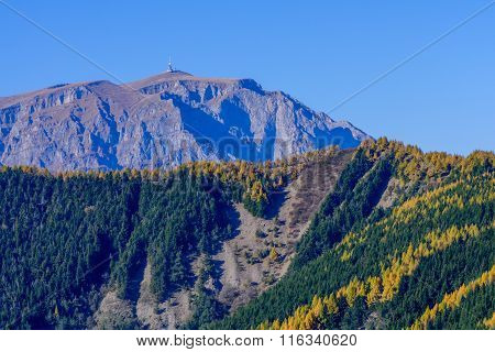 Rocky Towny In Autumn Mountains. Rocky Mountain Peak With Autumnal Forest Around In Fall Season..