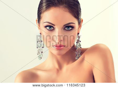 fashion woman with jewelry set . girl with   fashionable jewelry , earrings  and ring
