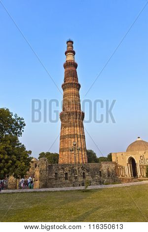DELHI, INDIA - AUG 3, 2013: Qutb Minar Delhi the worlds tallest brick built minaret at 72m built between 1193 and 1386
