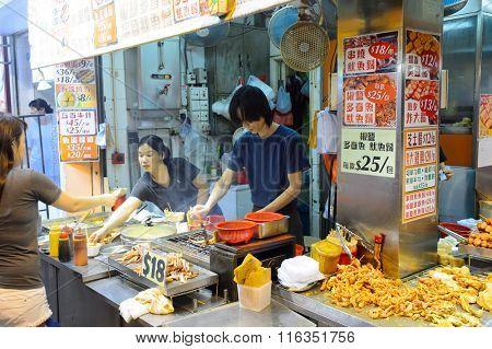 HONG KONG - JUNE 01, 2016: street cafe at Mongkok. Mong Kok often abbreviated as MK is an area in the Yau Tsim Mong District, on the western part of Kowloon Peninsula in Hong Kong.