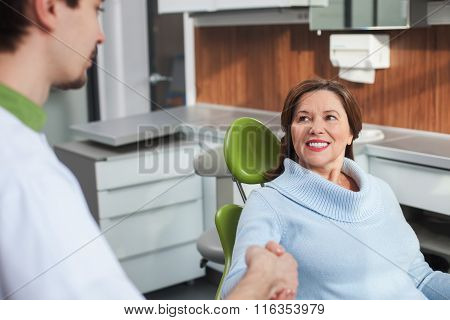 Cute mature lady is visiting the orthodontist