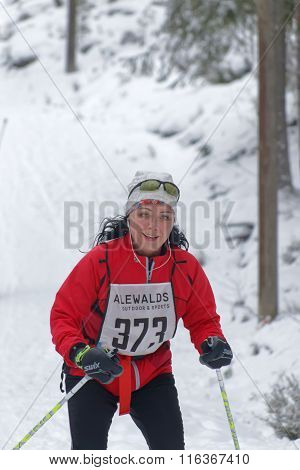 Smiling Cross Country Skiing Woman Dressed In Red