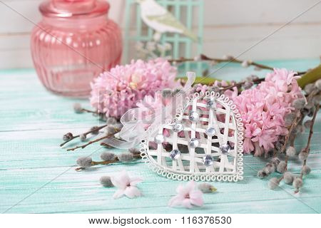 White Decoratve Heart With Hyacinths And  Willow Branches  On Turquoise Painted Wooden Planks.