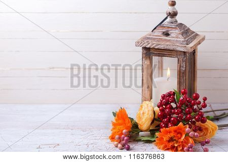 Autumn Still Life Photo With Flowers  In Yellow Colors And Candle In Lantern On Wooden Background.