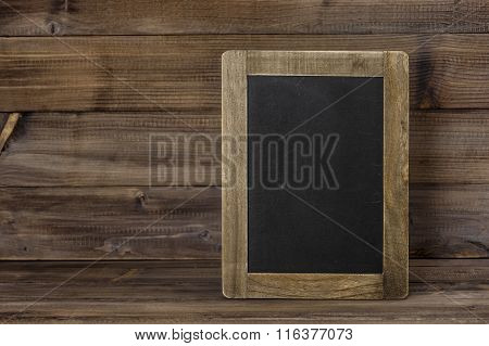 Chalkboard On Wooden Texture. Rustic Vintage Background