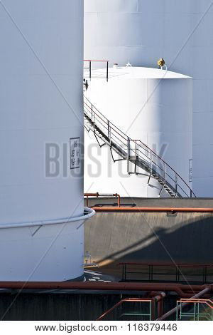 White Tanks In Tank Farm With Staircase